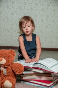 Child reads story for toy.