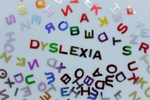 Dyslexia in a sea of random colorful letters and symbols